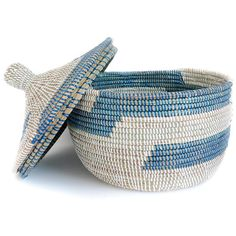 Blue/Turquoise Senegalese Accent Basket.  Hand woven by the the Wolof craftswomen in rural Senegal. The tribe uses traditional techniques to hand weave these graphic printed baskets from millet grass stalks and colorful recycled plastic threads. Perfect to hold toiletries-use them for laundry, towels, toys or as entryway catchalls.