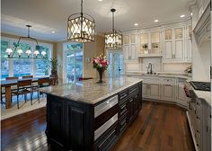Gorgeous kitchen with beautiful lighting fixtures