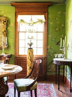 Gorgeous antiques furnish this Dining Room in this fine,old house.