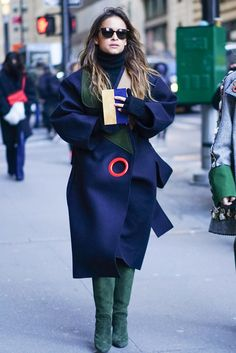 An oversized coat paired with suede boots.