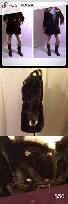 """1970's vintage black faux fur coat Adorable 1970's women's vintage black faux fur coat. Adorned with gold buttons and a super cute belt! Made by J.C.Penney's Fashions. Excellent condition! This snuggly fits a size 6-8 mannequin so it'd be considered a small/xs. Measurements are as follows: shoulder to shoulder - 16"""", chest - 17.5"""", sleeves - 20"""", waist - 15.5"""", length - 30"""". 1970's vintage Jackets & Coats"""