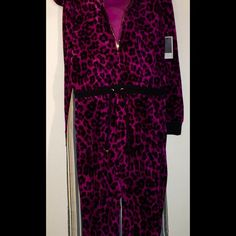 "Juicy Couture Leopard Hooded Jumpsuit ~ Size Small - Small Juicy Couture Leopard Hooded Jumpsuit (Or you can call it CHEETAH, SAFARI, OCELOT, or ANIMAL PRINT). - Color: Raspberry  (I selected colors ""PINK"" & ""PURPLE"" on listing b/c ""RASPBERRY"" was not listed!) - Still has tags but orig price not on tag. So, I'm not sure if there was another tag attached to it.  ~ Please contact me if any questions!  Thanks😎 Juicy Couture Pants Jumpsuits & Rompers"