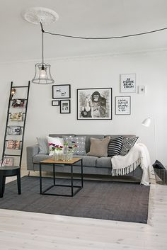 black and white, frames, ladder, grey sofa, clean