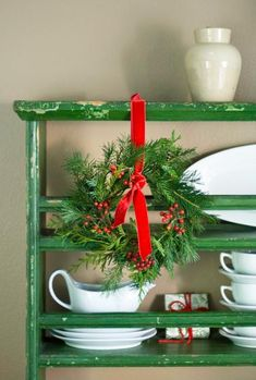 Add a small wreath to a shelf or on the back of a chair. For more easy Christmas decorating ideas: http://www.midwestliving.com/homes/seasonal-decorating/quick-easy-holiday-decor/page/31/0