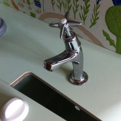 I didn't want to put the old wooden play tap back so I managed to get an old tap from a friends father in law who is a plumber.  I took the little plastic cap off the top (which was blue - for cold) and re-sprayed it cream and affixed it back on.  I cleaned the tap up and think it looks fab! Wooden Play Kitchen, Diy Kitchen, Things To Think About, Old Things, Plastic Caps, Me Clean, Plumbing, Law, Father
