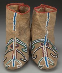 A PAIR OF SEMINOLE BEADED HIDE MOCCASINS c. 1870