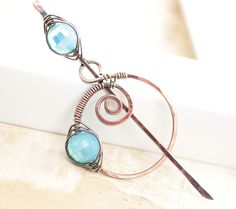 Shawl pin, scarf pin with penannular  spiral and tropical blue AB finish glass beads. $28.00, via Etsy.