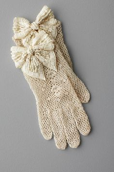 From another era. I would like these bows on black gloves...and pink satin bows on these crocheted gloves
