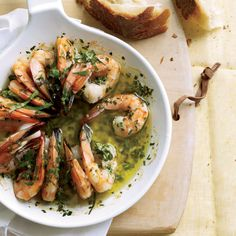 Sizzling Shrimp Scampi | The recipe here calls for flavoring butter with lemon, garlic, parsley and thyme, then dotting it liberally on shrimp and roasting the shellfish until it sizzles.