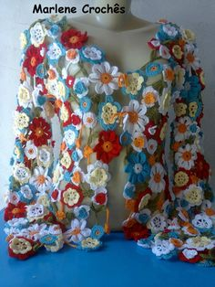 This woman has some beautiful crochet patterns for sale. Crochet Flower Tutorial, Form Crochet, Crochet Flower Patterns, Crochet Designs, Crochet Flowers, Crochet Hooks, Crochet Jacket, Crochet Cardigan, Irish Lace