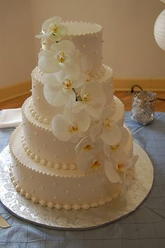 "Elegant and Stunning using White Orchids  If I had a ""wedding wedding"" this is as far as I'd go in terms of a cake."