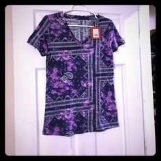 *NWT* Navy Lilac Print Tee *NWT* Navy Lilac in color with a bandana like pattern printed on shirt. Color almost seems tye dye. Very adorable summer shirt!! Tops Tees - Short Sleeve