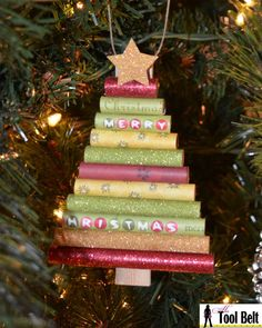 Create an easy unique handmade ornament, kids will love this rolled paper Christmas tree ornament.