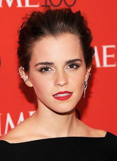 Emma Watson with perfect up-groomed brows with a matte red lip and illuminated skin