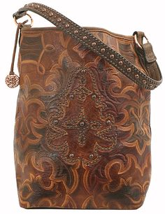 . tooled leather long bag