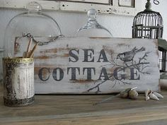 Shabby sea cottage sign