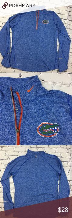 Nike Dri-Fit Long Sleeve Florida Gators Top Nike Dri-Fit Long Sleeve Florida Gators Top   Florida Gators colors in Blue with orange accents, half-zip athletic shirt with raised collar and thumb holes on sleeves   Size: XL Nike Tops