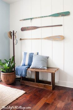 Wall oars in entryway / foyer. For more oar decor ideas, go here: http://www.completely-coastal.com/2009/02/decorating-nautical-with-wooden-oars.html