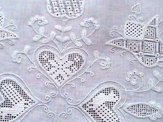 Schwalm embroidery - worked on white linen. Schwalm is whitework characterized by bold 'folky' designs (more about it at this site)