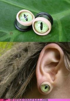 Snake eye ear lobe gauges. I am not into the guage thing but these are down right creepy...LOL