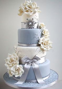 Winter Blue / Grey and White Wedding Cake with Brooch Accent