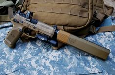 FN45 Tac with RMR, X5L and Silencerco Suppressor:  15+1 of venerable man stopping .45 ACP.  The FN 45 was developed using SF guidelines for a new pistol capable of extreme rugged reliability, long service life, accuracy and combat effectiveness. Barrowing many of the best features from the likes of the 1911, Sigs and Glocks; the FN 45 is truly a shinning example of a modern combat  sidearm.