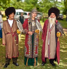 The Turkmen falconers in their traditional dress ( Image by Anguskirk )