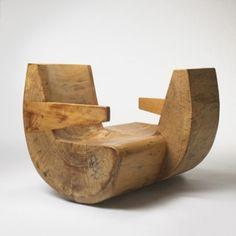 Brazilian designer Zanine Caldas utilizes salvaged lumber to create sculpted furniture.