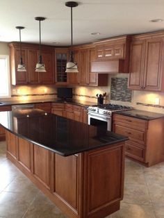 black granite countertops in a classic wooden kitchen with kitchen island