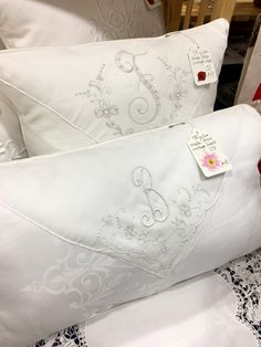 Take old monogrammed linens and turn them into pillows. I guess I am on the search for monogrammed napkins. Love this!