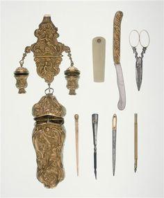 Gold chateleine with 'necessaires de toilette' - looks like razor, scissors, toothpick, nail file, etc