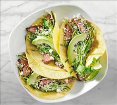 Carne Asada Tacos - This fresh combo of chipotle flank steak, Nikos® Fat Free Feta, cilantro, cabbage and avocados is super simple to make and so tasty!