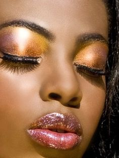 Rustic wedding make up: The ombre blend of purple, copper and gold on the eyelid and the light plum and gold glitter on her lips is stunnong. Extremely kissable lips at your wedding reception. Beauty - Hair and Makeup Color Family: Gold Cultural Influence: African-American Next » « Prev Close