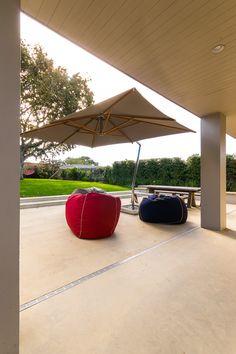 Coloured concrete patio designed by Landsmiths Colored Concrete Patio, Concrete Patio Designs, Concrete Patios, Sandstone Color, Patio Ideas, Paths, Garden Design, Pergola, Deck