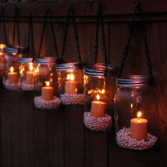 Mason Jar Lanterns along the fence@Katelyn Nicole (i saw that you posted another fence idea awhile ago) Ciera ☮ ♥ ⚓ via Rae Gunn onto Dreams for My Home
