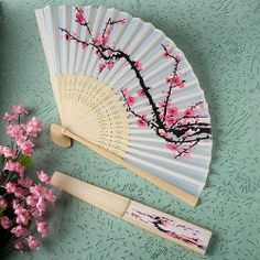 Your guests are sure to be big fans of these delicate cherry blossom design silk folding fan favors! Brilliantly displaying a cherry blossom branch - a traditional symbol of true love - these fan favors are simply sensational. A pretty and useful choice Cherry Blossom Fiesta, Cherry Blossom Wedding, Blossom Flower, Cherry Blossoms, Destination Wedding Favors, Wedding Favours, Bridal Shower Favors, Party Favors, Wedding Centerpieces