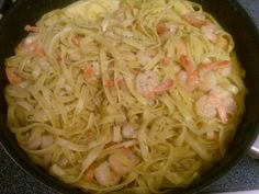 """Step by step (Fectuccinee al Alfredo) boil water for noodles(add noodles  to boil water what the box says for cook) in other pan over medium heat add little oil,them 3 tablespoons of butter,and then when the butter is melted then add shrimps,sal,black pepper,leaves,2 head of garlic and then move right. Then add 1cup of evaporated milk and then half a cup of parmesan cheese, later take out the 2 garlic from the pan and start to put the spaghetti and move and then your done. """"Buon appetito""""!"""