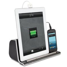 Tablet and smartphone charging station and speaker omg so need this for my massage space :)