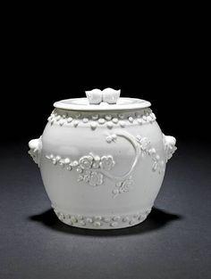 A rare blanc-de-chine barrel-shaped jar and cover. 18th century.