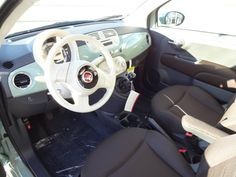 2013 FIAT 500 Pop For Sale | Wilmington NC . Love the interior of this light green pop! The white steering wheel pops the retro look!