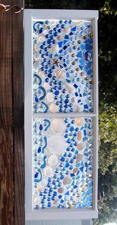This Garden Glass Window is called 'Mosaic Shells Blue'.