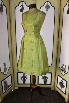 Green '60s brocade dress with tiny rhinestones on the buttons. Love.