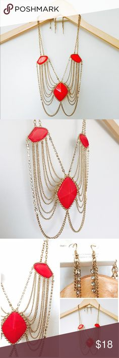 Draped Chandelier Necklace Set Beautiful new with tags draped chandelier necklace set. Rhinestone chain and gold tone chains. Red faux acrylic stones. Adjustable chain. Drop earrings for pierced ears. Fashion jewelry. Jewelry Necklaces