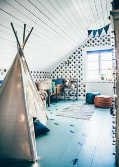 10 Cheerful Kids Rooms - Petit & Small- This would be great to to in our attic!!!