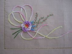 *EMBROIDERY ~ Palestrina stitch used for the 'ribbon', Raised Buttonhole stitch for the main flower, Bullions for the small flowers, Feather stitch & French Knots for the floral stems & 2 rows of alternating Back Stitch for the stems.