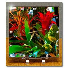 A plant with flowers done in a digital watercolor with green and red Desk Clock