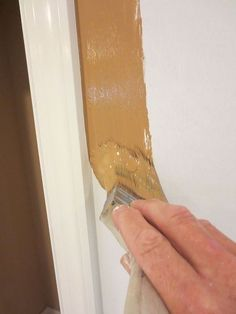 painting a straight line next to the trim trick, painting, Loading up your 3 brush full with paint helps you to find your line With subtle pressure run the tips of the bristles to the corner You will find the right resistance to your bristles in the corner to make the line straight