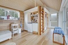 This Scandinavian Modern tiny house in Denmark has a 258 sq ft studio floor plan with sleeping loft.   www.facebook.com/SmallHouseBliss