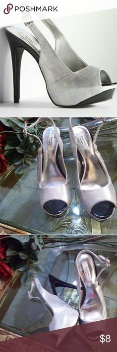 Silver Open Toe Simply Vera Vera WongPlatform hoes Silver with black and some white simply vera Wang shoes, they are comfy. They are used have some scuff on exterior and marks of worn. Please see pictures.   This item has visible signs of wear Simply Vera Vera Wang Shoes Platforms