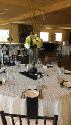 Tall centerpiece, mini green hydrangea, ivory roses, curly willow, pre-lit branches